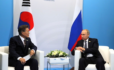 Russian President Vladimir Putin with President of South Korea Moon Jae-in.
