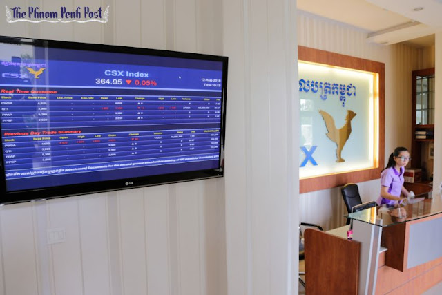 A monitor displays the Cambodian stock market index next to the reception of the CSX earlier this month in the Kingdom's capital. Heng Chivoan