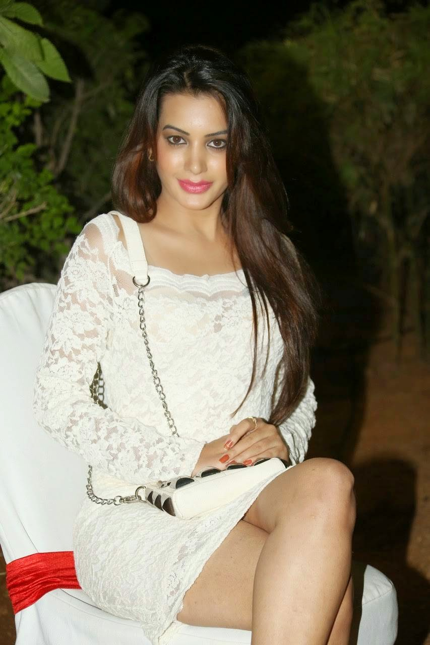 Diksha Panth Pics in White Dress, Actress Diksha Panth Crossleg Sitting Pics in White Dress from Event