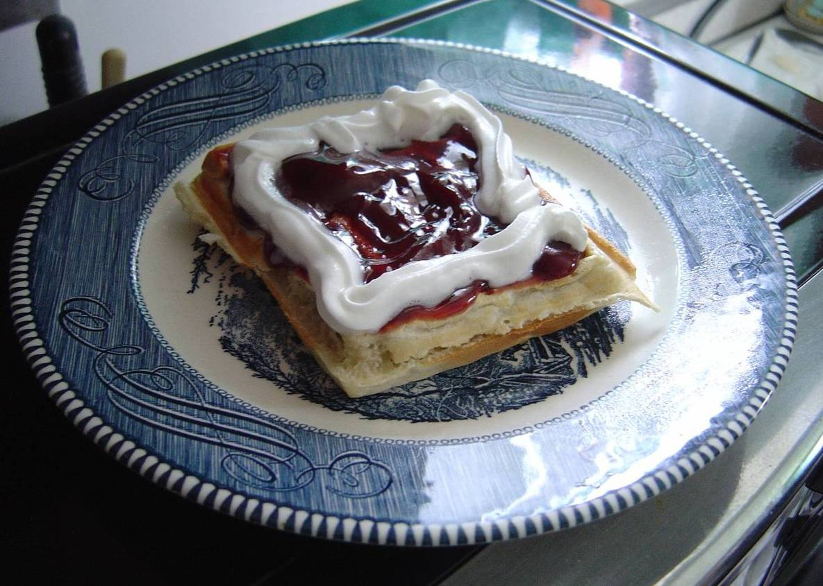 homemade belgian waffle with strawberry topping.jpeg