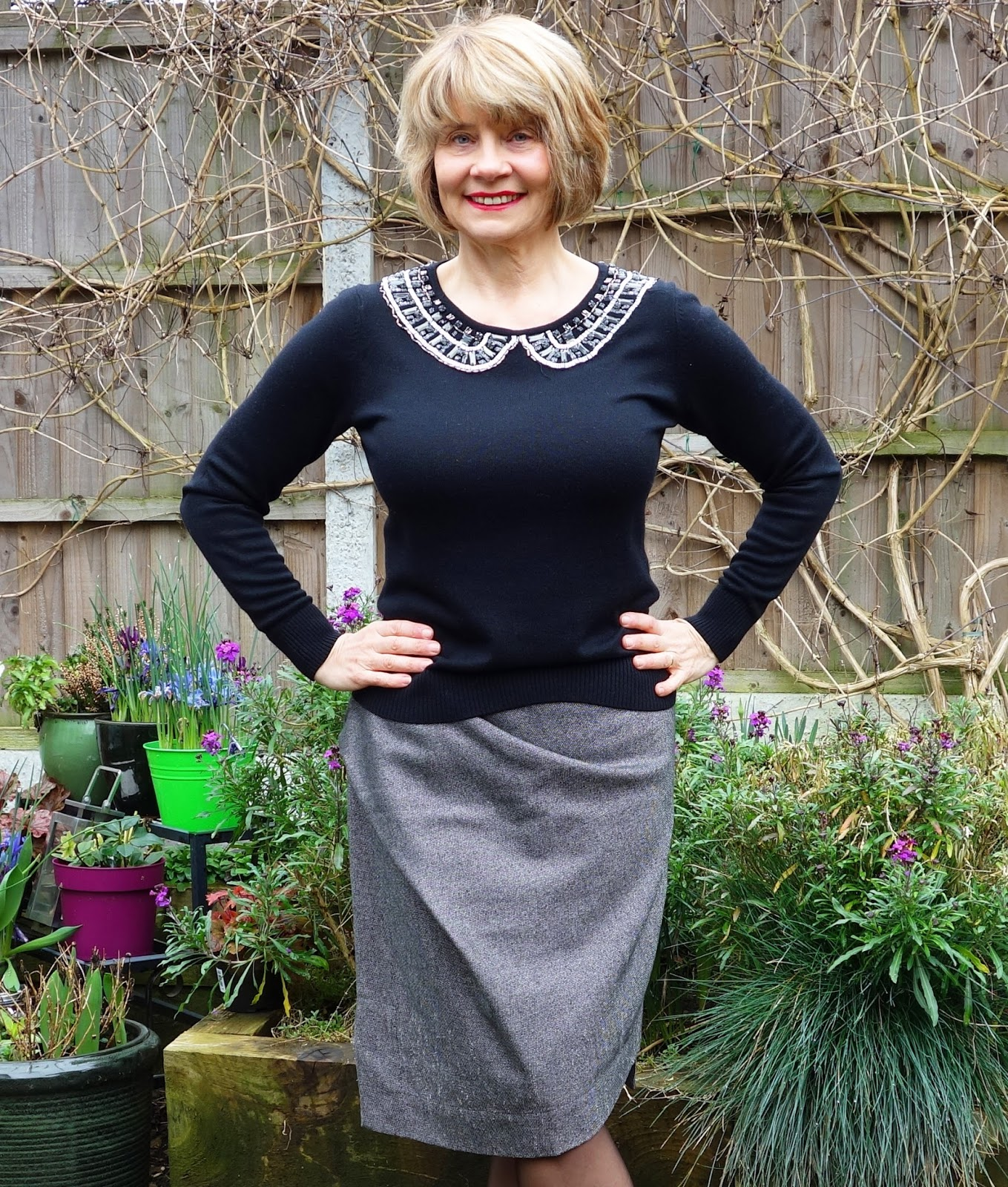 Confidence clothes: Image showing woman wearing a grey Vivienne Westwood draped skirt and black embellished jumper from Boden