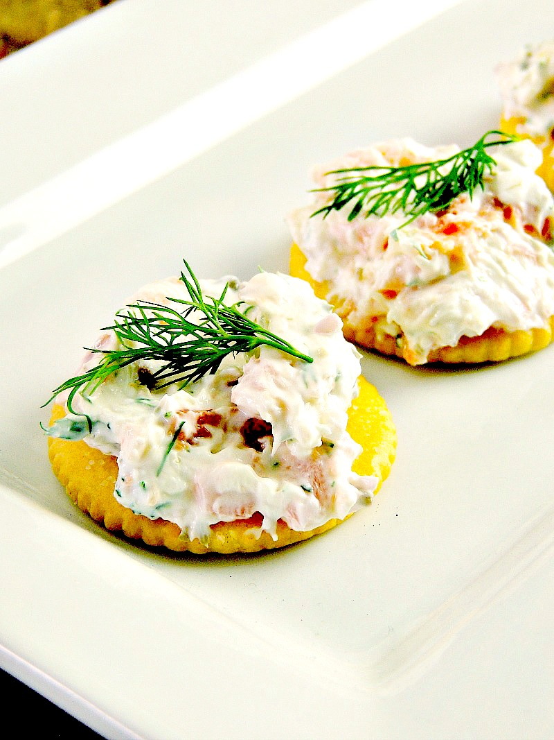 Smoked salmon appetizer bites on a white serving tray.