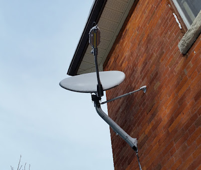 a photo of my xplornet internet satellite mounted to an exterior brick wall of my house
