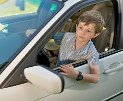 A small boy driving