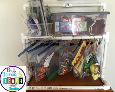 DIY Hanging Bag Shelf for storing station materials and Busy Bags.