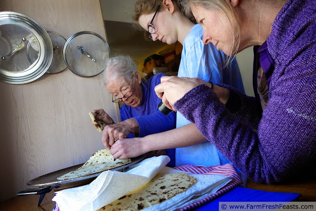 three generations of women making lefse in the kitchen together