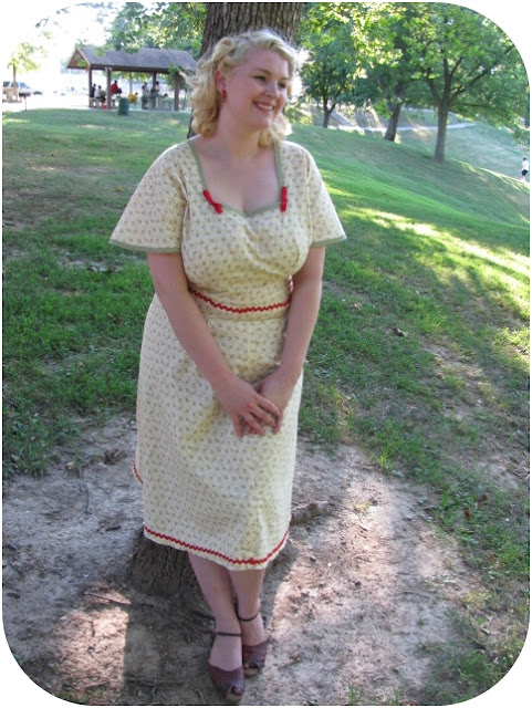 1940s marion martin plus size dress with back cut out and vintage pin curls