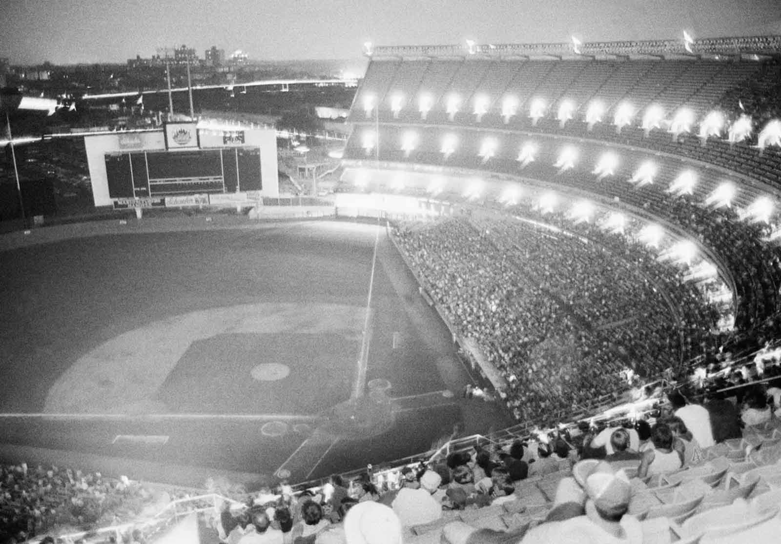 New York's Shea Stadium lies in darkness during the bottom of the sixth inning after the lights went out during the game with the Chicago Cubs, July 13, 1977.