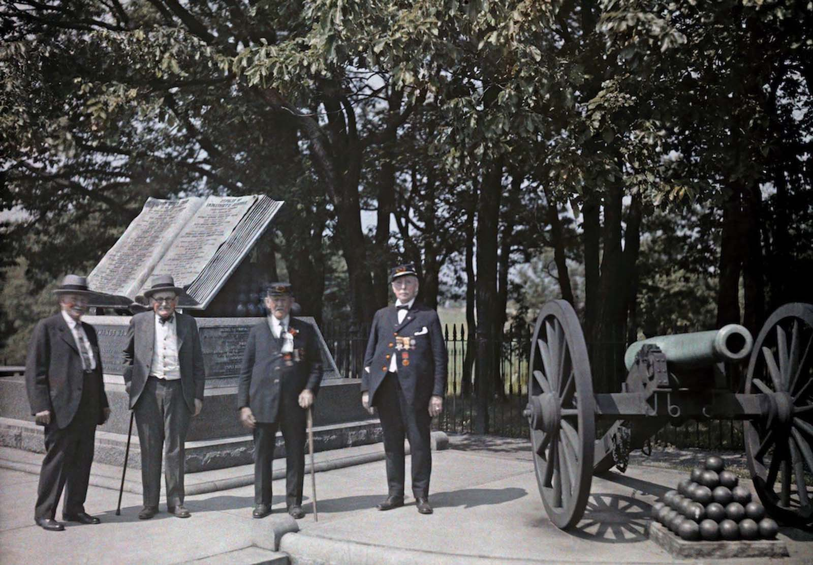 Gettysburg National Military Park, Gettysburg, Pennsylvania — Union Civil War veterans stand in front a monument at Gettysburg. 1931.