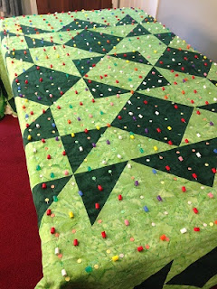http://leahday.com/products/quilting-a-king-on-your-home-machine