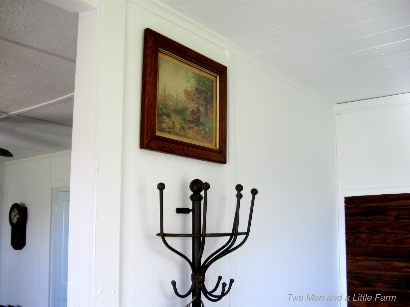 two men and a little farm wall mounted coat rack. Black Bedroom Furniture Sets. Home Design Ideas