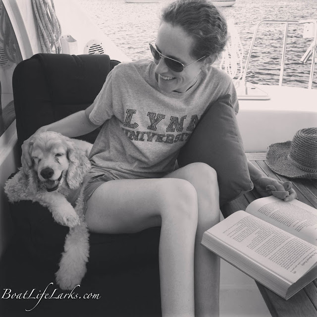 Lucy and Hastings share a seat on their catamaran