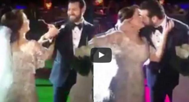 قبلة عمرو يوسف لزوجته كندة علوش التي اثارت ضجة عارمة في حفل زفافهم و هكذا كانت ردة فعل كندة لهذه القبلة المفاجئة