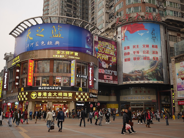 large advertisements viewed from Shangxiajiu Square in Guangzhou