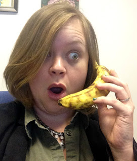 April's shocked face talking on a banana as a phone