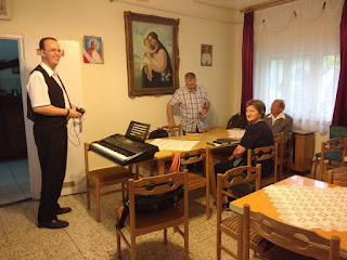 Pastor Csaba and small group setting up for meeting