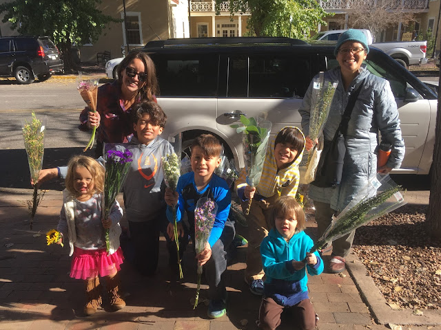 Giving out free flowers in Santa Fe Plaza