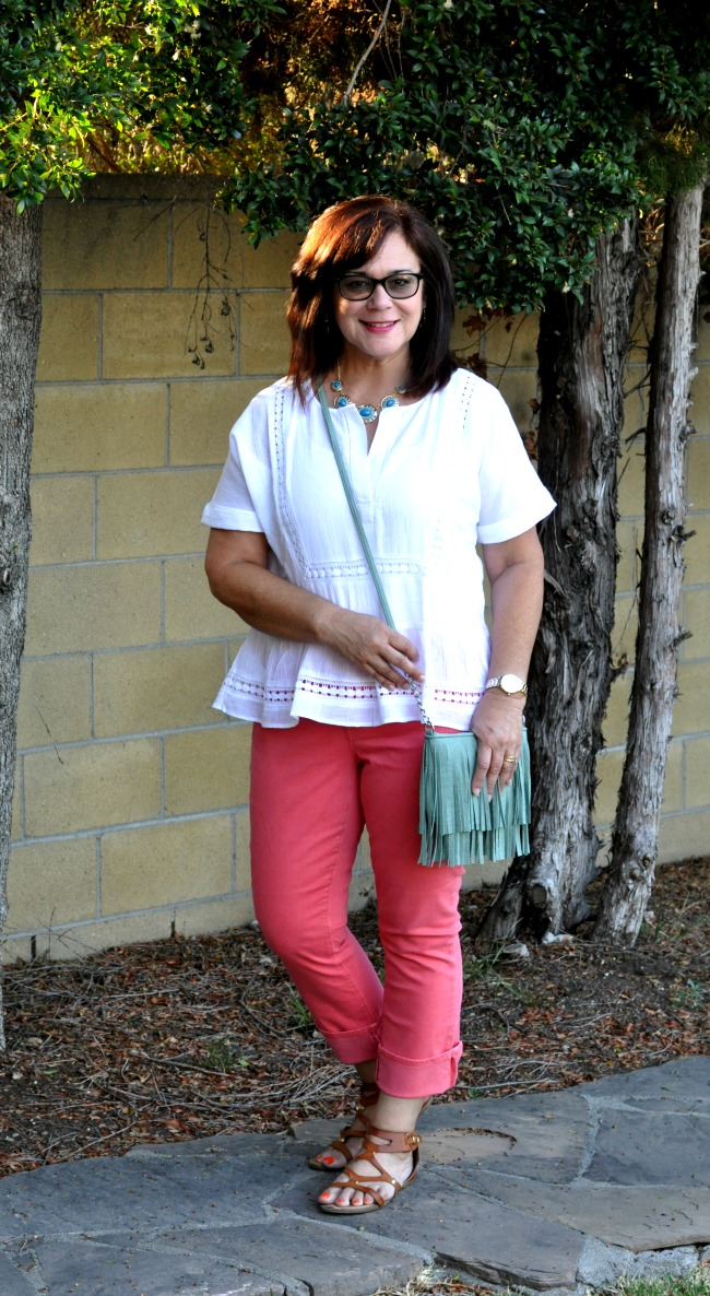 coral jeans and white cotton top