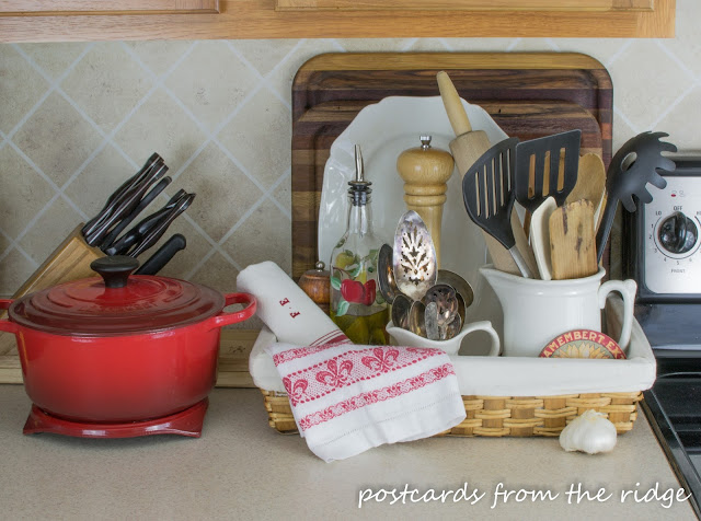 Corral the counter clutter with a pretty basket plus many more kitchen organizing ideas.