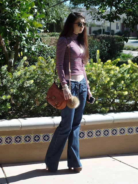 flare jeans outfit idea- cropped turtleneck and boho accessories