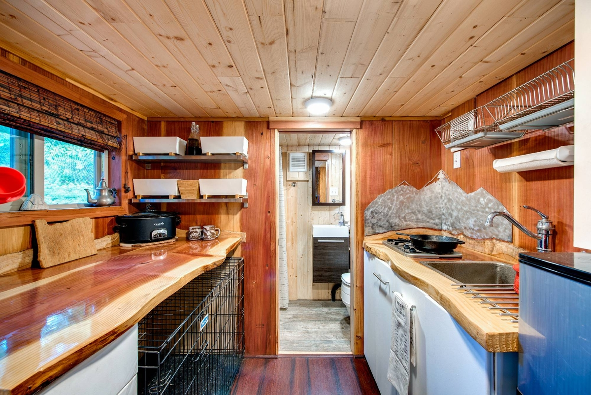 08-Kitchen-and-Bathroom-Backcountry-Tiny-Homes-Basecamp-Tiny-House-on-Wheels-with-Rooftop-Balcony-www-designstack-co