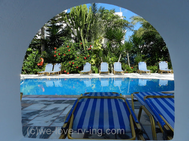 Photo is taken through a portal beside the pool area at Pension George