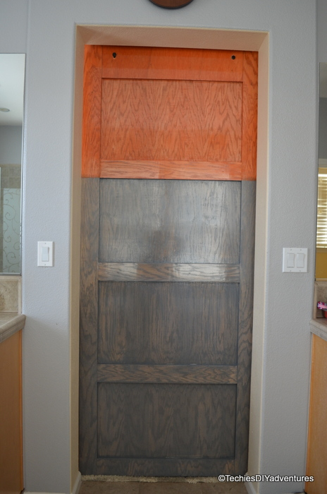 Orange and gray stained 5 paneled door