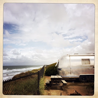 Airstream on ocean cliff