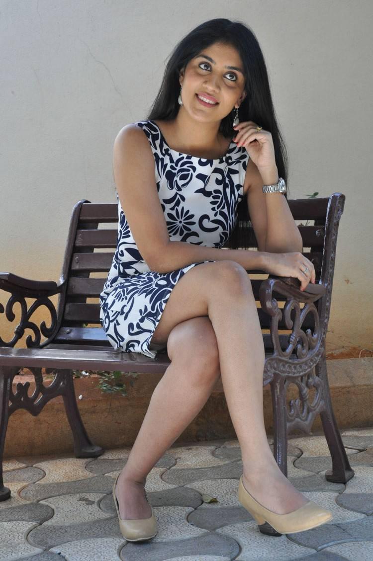 Actress Dhanya Balakrishna Hot Thigh Show Stills In Mini Black Skirt