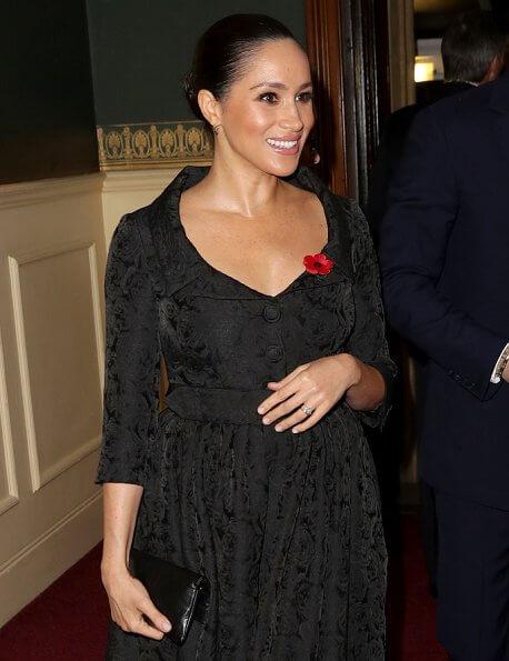 Meghan Markle is wearing Jessica McCormack Gypset Ruby hoop earrings. Queen Elizabeth, Kate Middleton, Prince William, Prince Harry