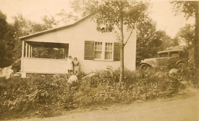 Mystery Photo! A house in the country with an epic porch. Check out that automobile! Also, two unidentified women.