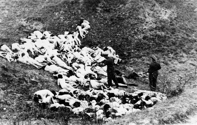 A German in a military uniform shoots at a Jewish woman after a mass execution in Mizocz, Ukraine. In October of 1942, the 1,700 people in the Mizocz ghetto fought with Ukrainian auxiliaries and German policemen who had intended to liquidate the population. About half the residents were able to flee or hide during the confusion before the uprising was finally put down. The captured survivors were taken to a ravine and shot. Photo provided by Paris' Holocaust Memorial.