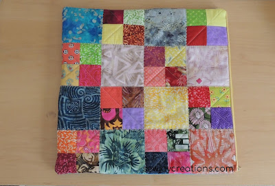 scrappy four patch blocks quilted cushion cover