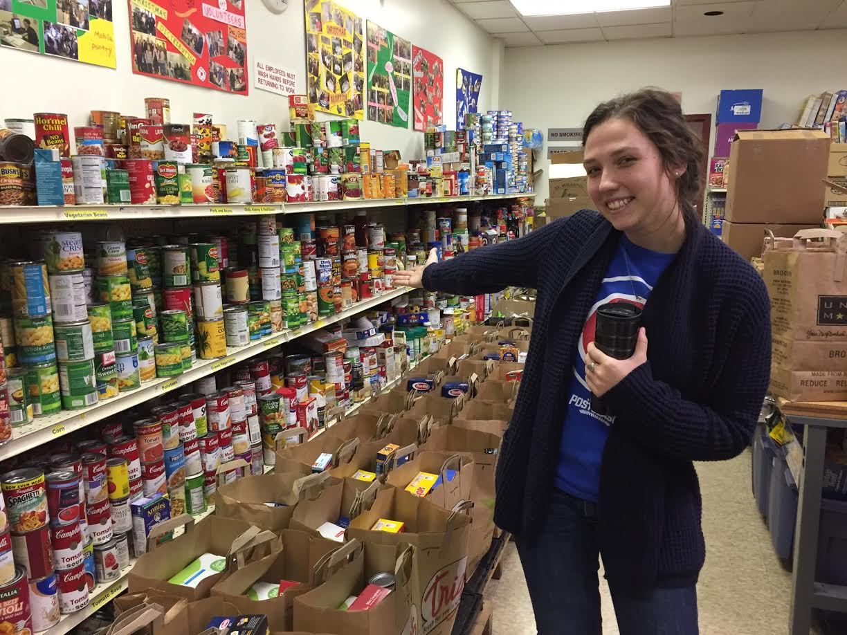 Clare Shows Off The Stocked Shelves Of The St. James Food Pantry.
