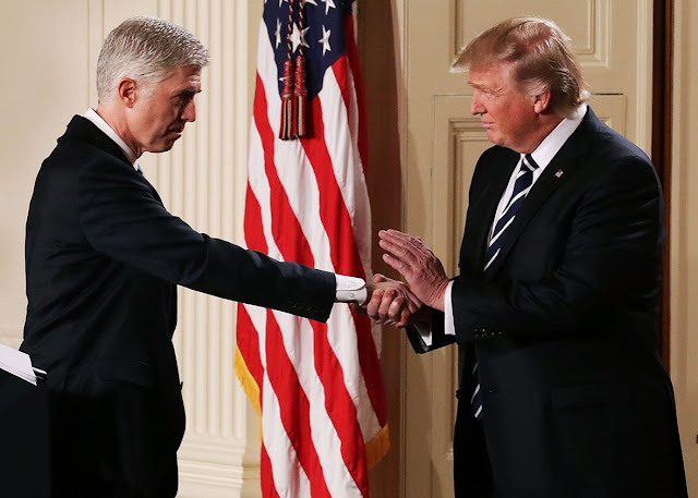 Neil Gorsuch shaking hands with Donald Trump. Chip Somodevilla/Getty Images