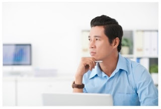 Man thinking about his website content