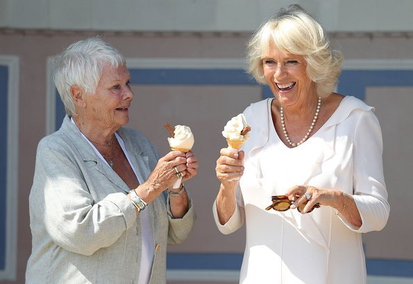 The Duchess of Cornwall was welcomed by Dame Judi Dench – the patron of the Friends of Osborne and curator of Osborne House, Michael Hunter