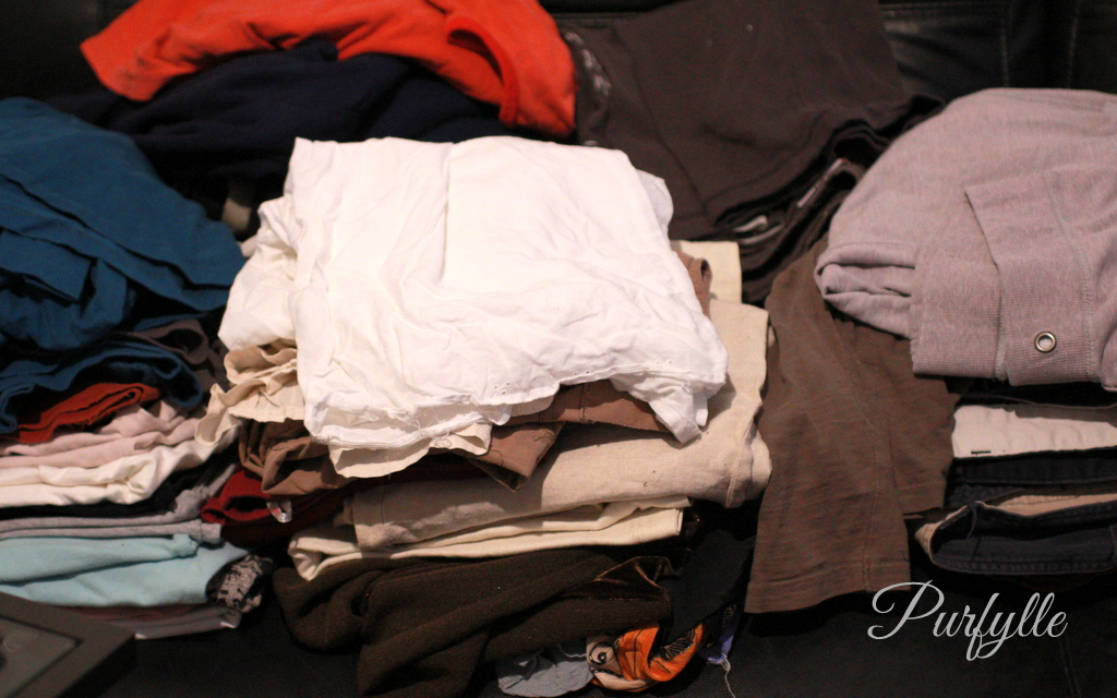 5 piles of clothes