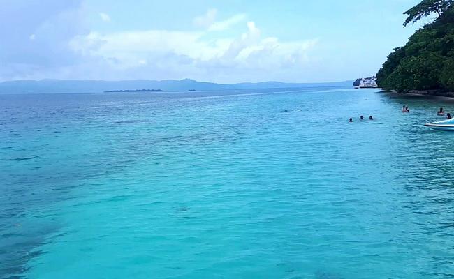 Xvlor Liang Beach is white sandy coast to north of Leihitu Peninsula