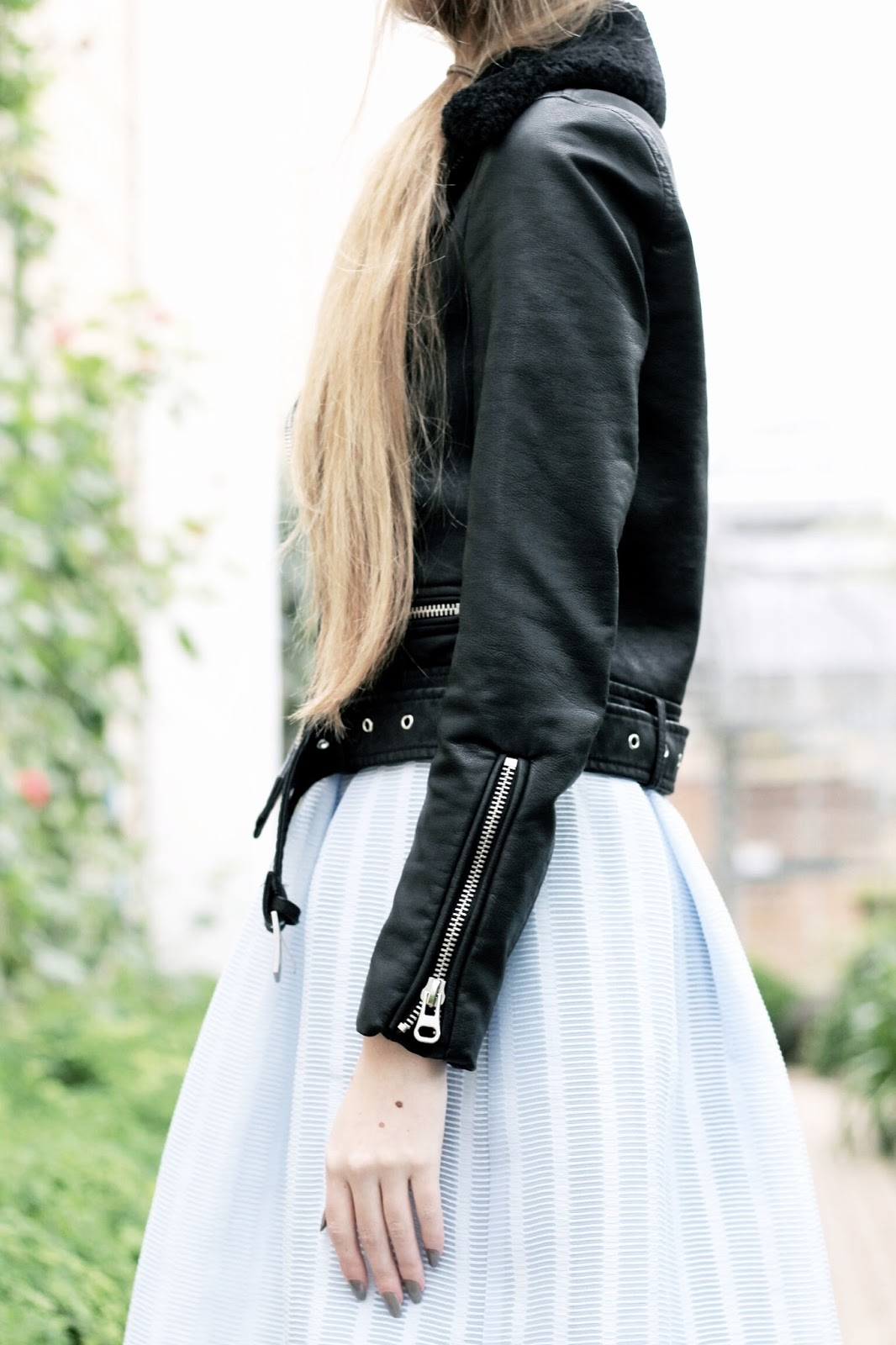 Styling a leather jacket with pretty dress