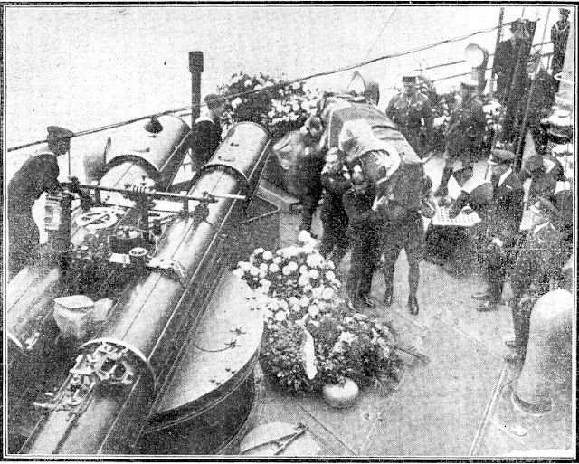 The Unknown Warrior being removed from HMS Verdun by soldiers, a sailor and an airman.