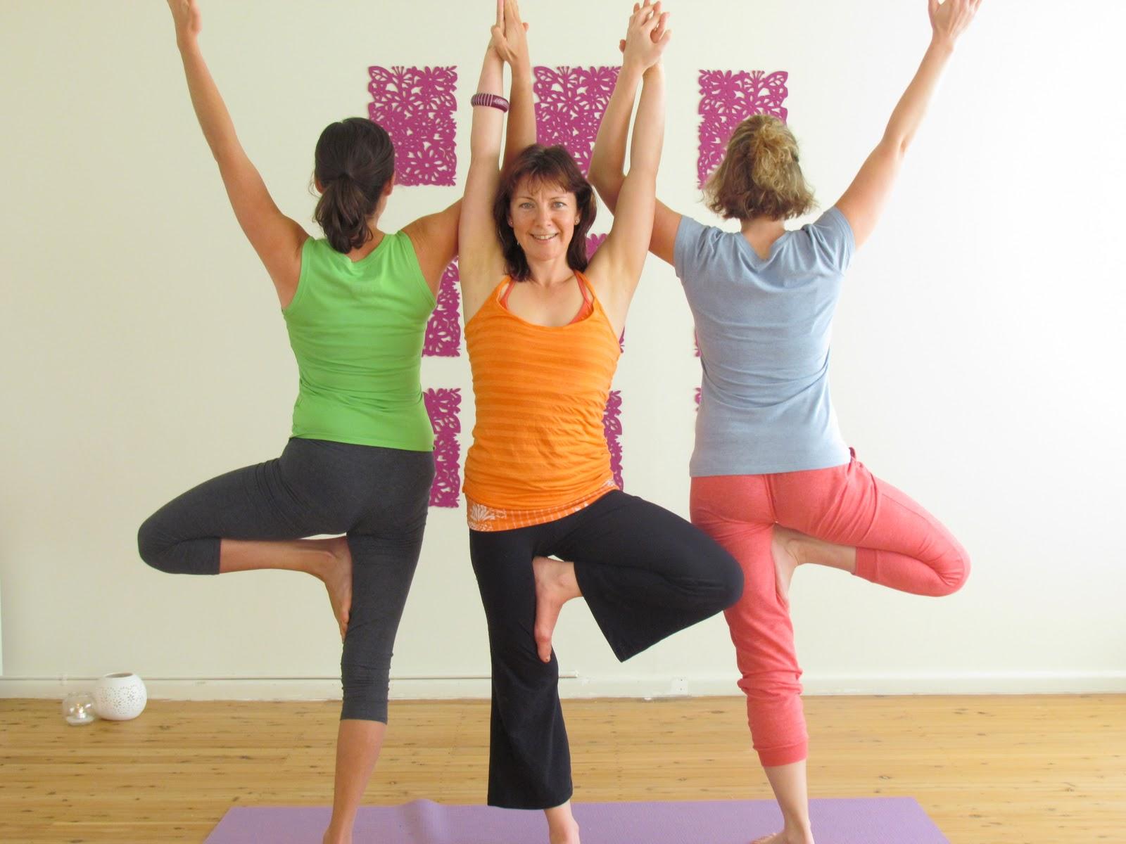 three people yoga challenge poses