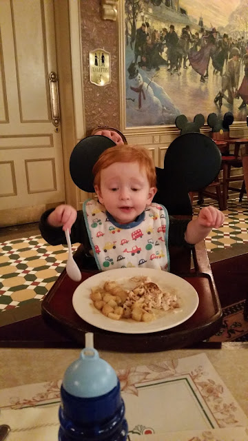 Toddler in a Mickey highchair