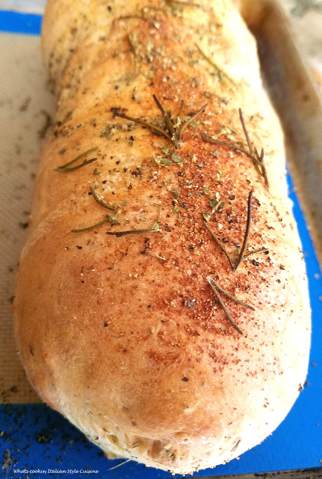 Stuffed Bread dough with cheese Italian food that's like pizza This is delicious pizza dough stuffed with cheese and fresh herbs. A  homemade bread dough that was mom's recipe. This is called a focaccia and italian herb bread that is stuffed with cheese. Rosemary is a main herb flavored in this bread along with black pepper and fresh basil