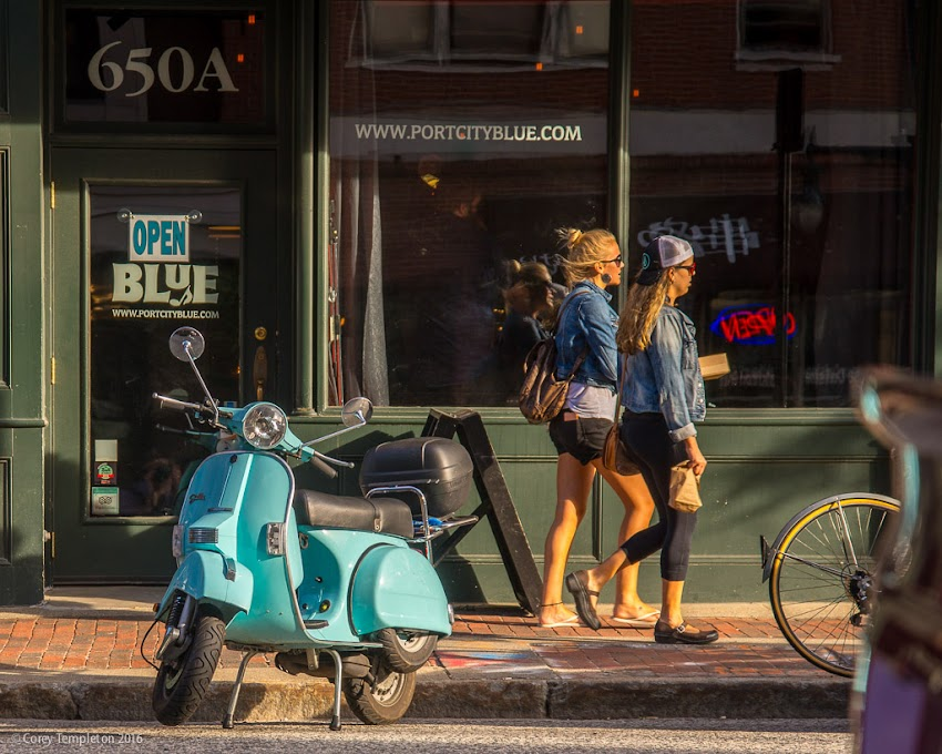 Portland, Maine USA July 2016 photo by Corey Templeton. A blue moped parked in front of Blue, at 650 Congress Street,