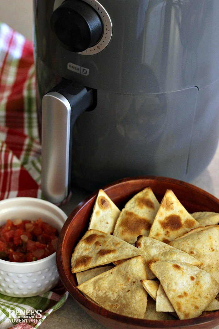 Dash Compact Air Fryer (gray color) with a bowl of corn tortilla chips and salsa in front