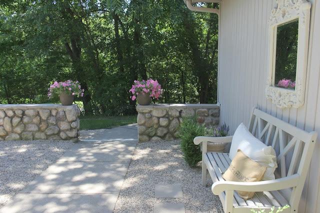 Hello Lovely Studio's French inspired pea gravel courtyard