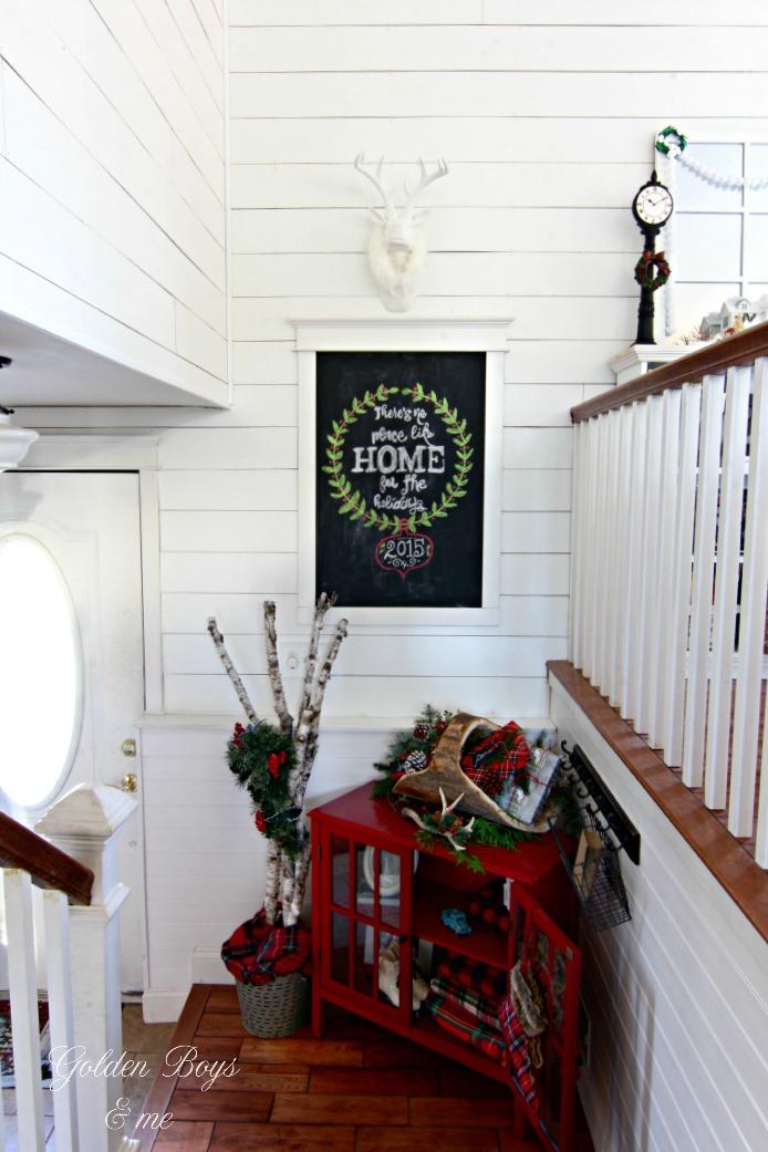 Entryway in split level home with Christmas decor - www.goldenboysandme.com