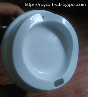 Nescafe logo embedded in the top of the cup of to go tumbler
