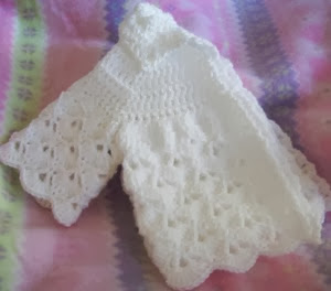 http://translate.googleusercontent.com/translate_c?depth=1&hl=es&rurl=translate.google.es&sl=en&tl=es&u=http://cats-rockin-crochet.blogspot.com.au/2014/02/little-fans-down-under-baby-sweater.html&usg=ALkJrhiCtauje_hU6w9WVzwzG00MfvkJDA